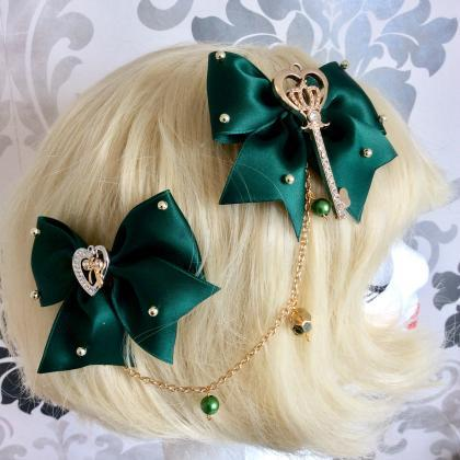 Pretty satin bows with pearl neckla..
