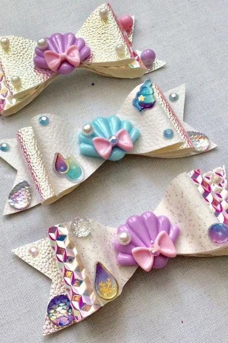 Mermaid holo hair bow cabochon resin white purple blue pink fairykei pastelgoth maritime sea galaxy scales shell fish kawaii brooch pin